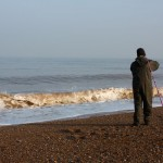 Sea fishing on the shingle beach at Cley