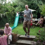 Nel entertaining guests in his garden in London
